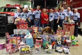 A pile of toys grows as community folks show their generosity by dropping off toys during the 2015 SLVFD toy drive to support Holiday Helpers.