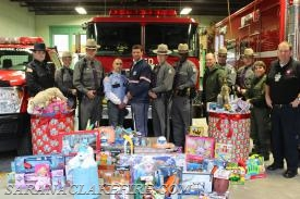 Area first responders participate in SLVFD's toy drive in support of the Holiday Helpers. Pictured the Saranac Lake Police Department, Rescue Squad, and Fire Department.  The New York State DEC and New York State Troopers and the US Postal Service.