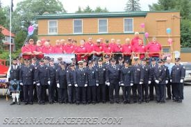 Past and present members of the SLVFD pose at the beginning of the Parade route.  Current Members are in Blue Class A uniform, Past are in red polo shirts.