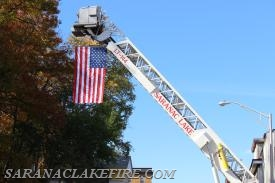 LT-144 displays the American flag over Broadway.