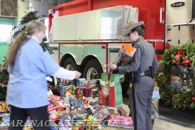 The New York State Police arrive with toys collected by NYSP-Ray Brook.