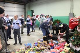 Area first responders and members of the community working together to bring holiday cheer.