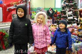 Area children delivering toys.
