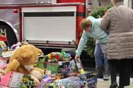 Community members delivering toys.
