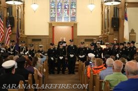 SLVFD Members on the right stand with recipients during award ceremony.