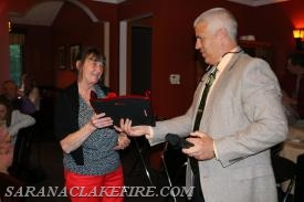 "Barbara Kent receives the ""Ruth King"" award from Chief Brendan Keough."