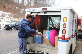 Saranac Lake Postal employees, showed up with a mail truck full of toys.