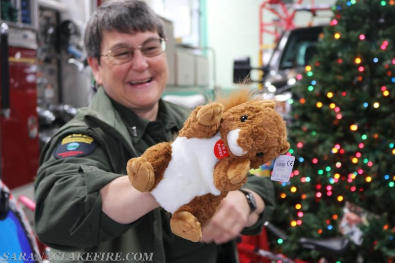 NYSDEC Forest Ranger, Lieutenant Julie Harjung drops off Toys for the Holiday Helpers.