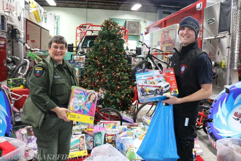 Saranac Lake Volunteer Rescue Squad members showed up with a large contribution to the Holiday Helpers.