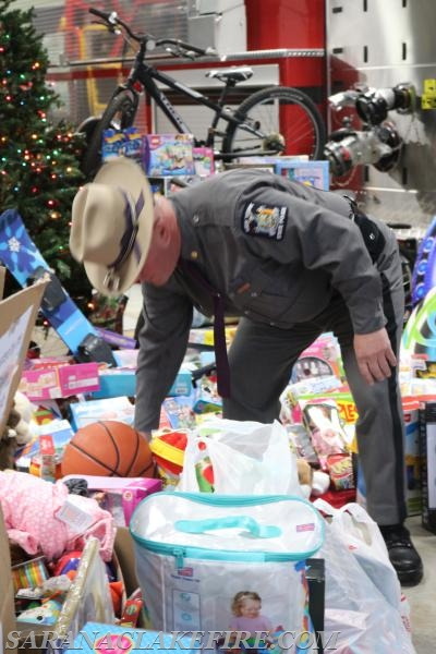 NYSP Troop B Commander, Major John H. Tibbitts Jr. places toys on the ever growing pile...
