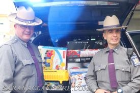 NYSP Troop B Commander, Major John H. Tibbitts Jr. and Trooper James D'Ambro drop off toys donated by the employees of NYSP Troop B