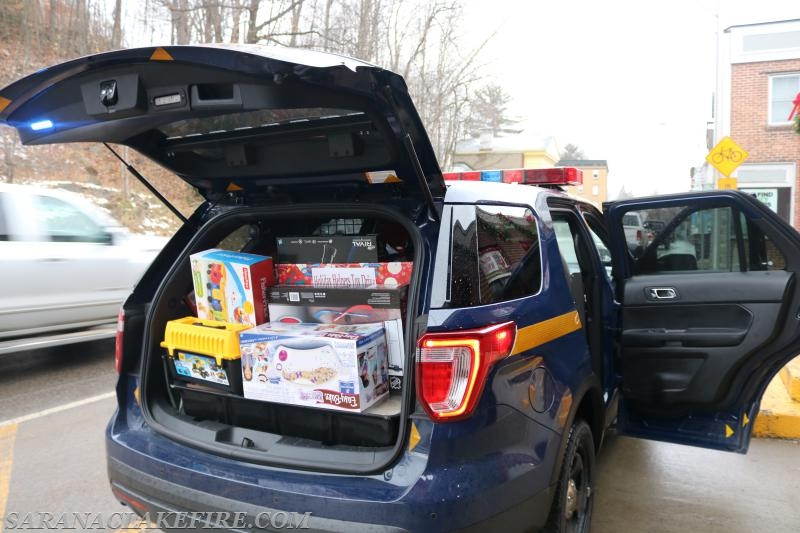 A New York State Trooper Vehicle packed with Toys arrives with contributions from the employees of NYSP Troop B