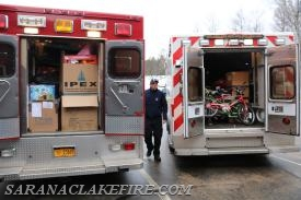 A look inside two really full emergency vehicles on a cheerful mission.
