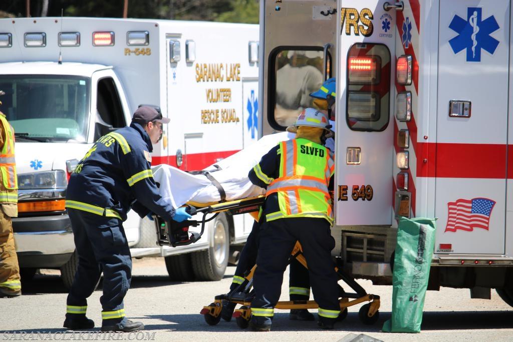 SLVRS members load a victim into an ambulance.