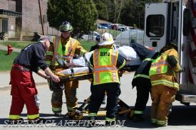 SLVFD and SLVRS members load a victim into an ambulance.