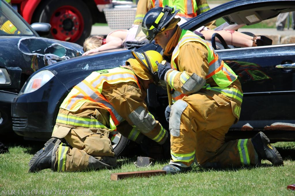 SLVFD Firefighters stabilizing/cribbing a vehicle .