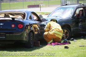 An SLVFD Firefighter places cribbing to secure a vehicle
