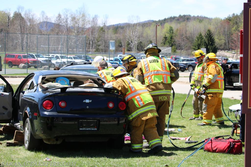 SLVFD firefighters using tools such as the Jaws of Life to extricate student actors.