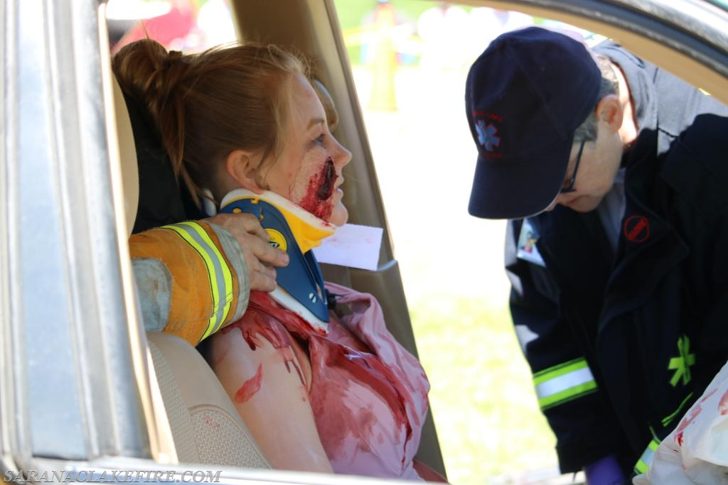 SLVRS attends to an accident victim during mock DWI crash.