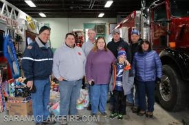 Members of Bloomingdale VFD pose with SLVFD Chief Keough and Holiday Helpers Co-Chairs Dawn Rogers and Patti Ploof