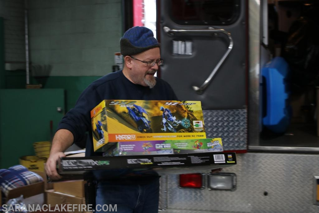 Loading up the presents in SLVRS Ambulance and SLVFD Heavy Rescue for delivery.