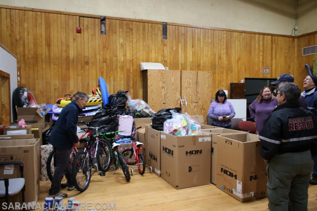 The presents were delivered to the Holiday Helpers distribution site to be sorted and distributed to the families in need...