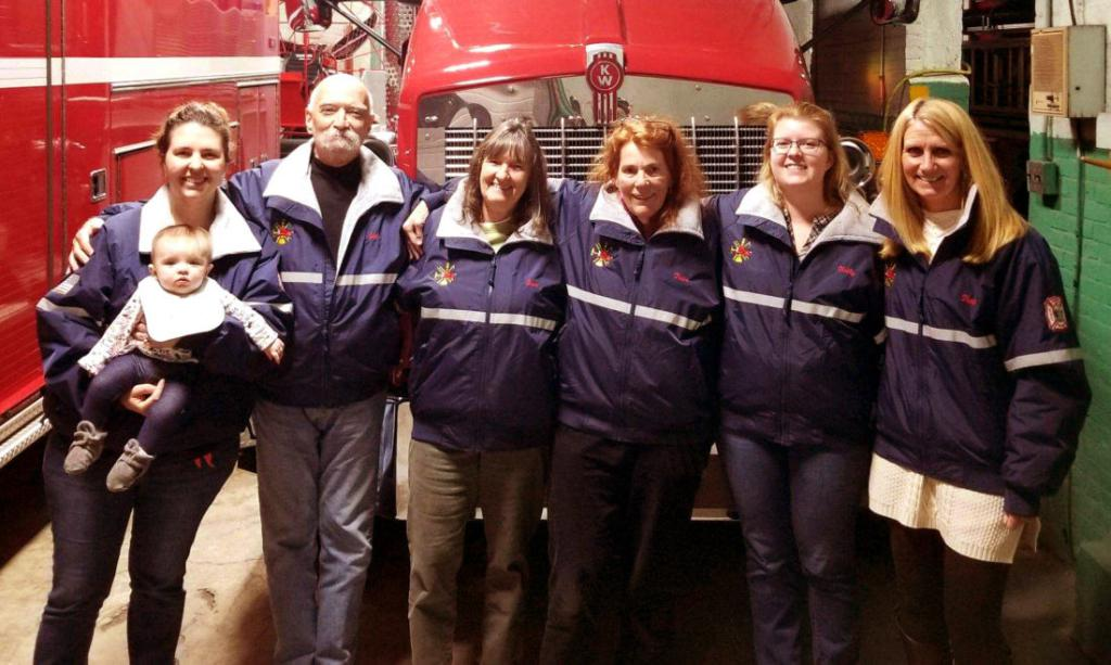 From the Adirondack Daily Enterprise:The newly formed Saranac Lake Volunteer Fire Department Auxiliary is pictured. Its mission is to support the firefighters of the Saranac Lake Volunteer Fire Department in their pursuit of life safety, incident stabilization, and environmental and property preservation of the citizens they serve. The members of the auxiliary pursue their mission through activities supporting the fiscal public service and response support needs of the firefighters. Pictured from left are Ashley Peck with Adalein Peck, John Vallini, Barbara Kent, Pattie Clark, Kelly Wright and Patti Sauvie. (Photo provided)