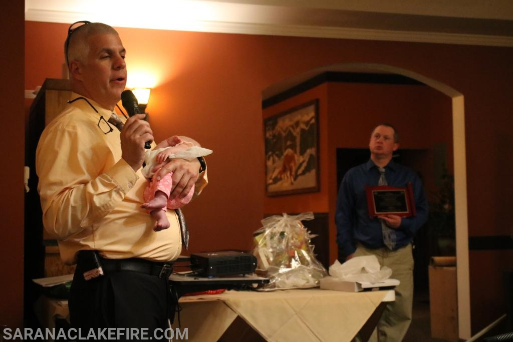 For most of the awards ceremony Chief Keough was very careful not to disturb his new granddaughter Maggie.