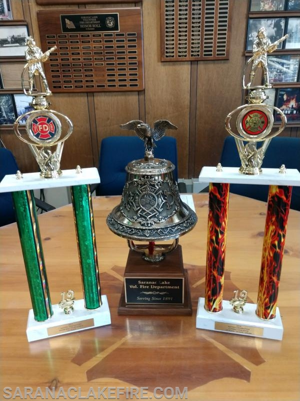 2 Trophies won at the convention sit next to SLVFD's ceremonial bell.