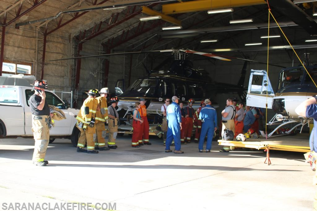 A group of first responders from the PSGVFD, SLVRS and the SLVFD await instruction at the Life Flight hanger at the Adirondack Regional Airport.