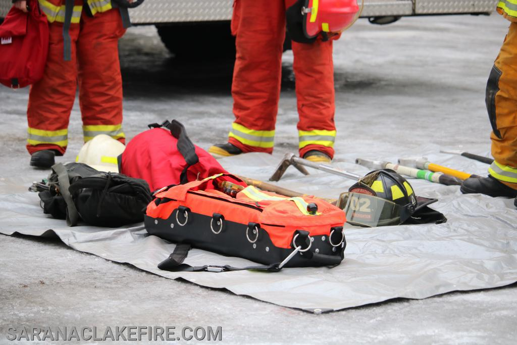 A RIT Kit, the orange bag contains, extra air bottle, fittings, and mask.  The RIT team carries this with them to resupply the downed firefighters who may be running out of breathing air inside the fire.