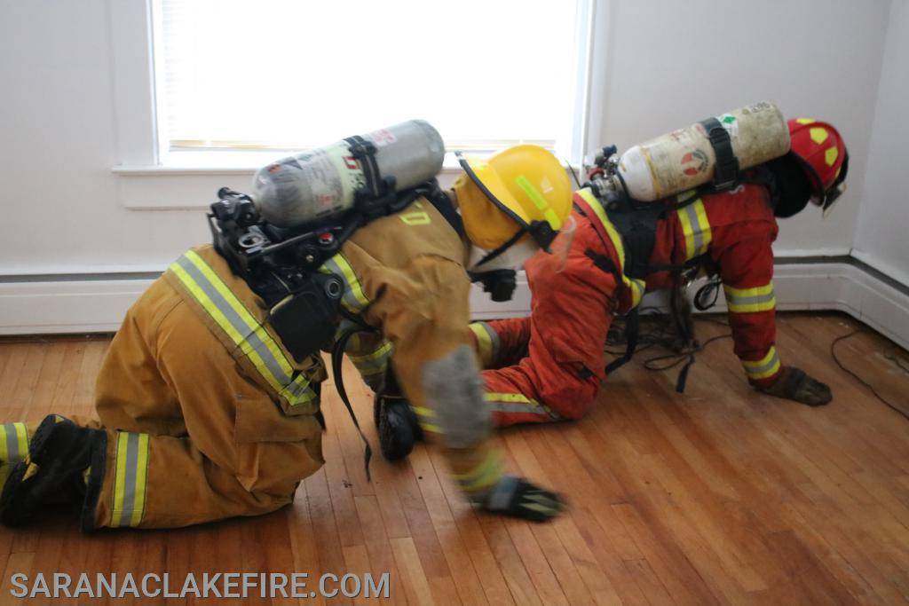 two firefighters conducting search and rescue.