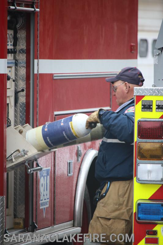 SLVFD Past Chief Andy McGill refills air bottles from portable compressor on Heavy Rescue 147