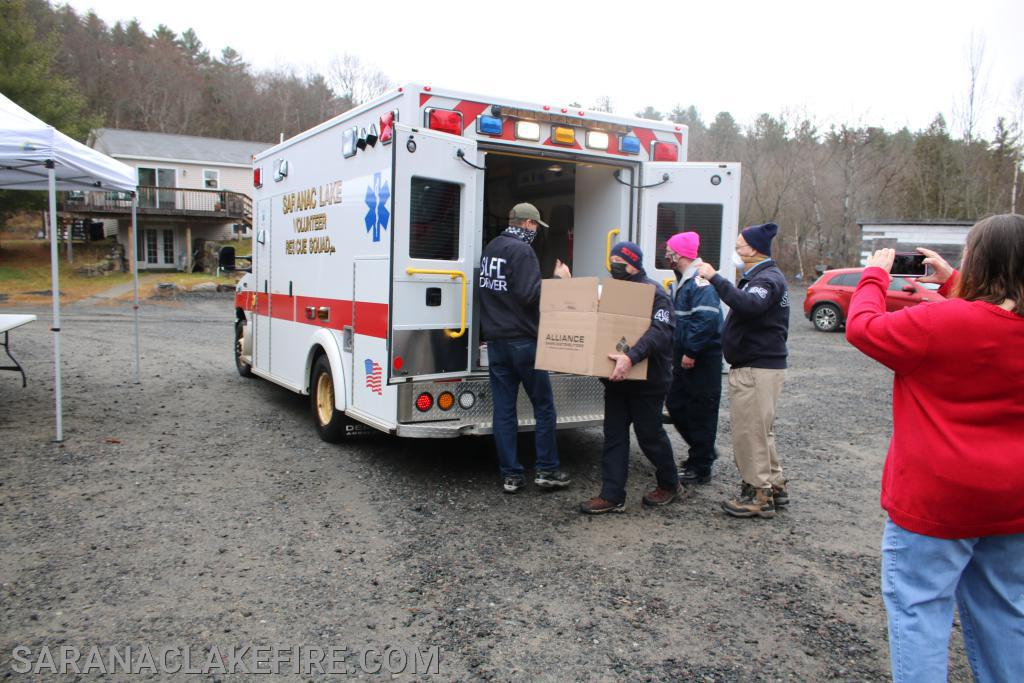 The Saranac Lake Volunteer Rescue Squad arrive with toys they collected