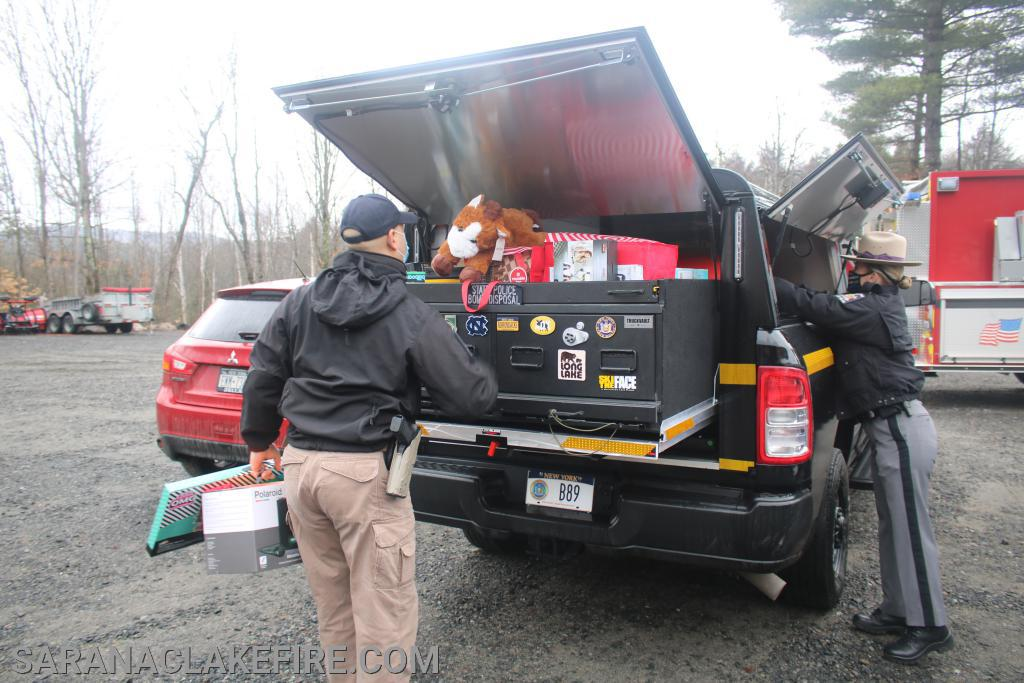 NYSP Troop B arrive with toys they collected