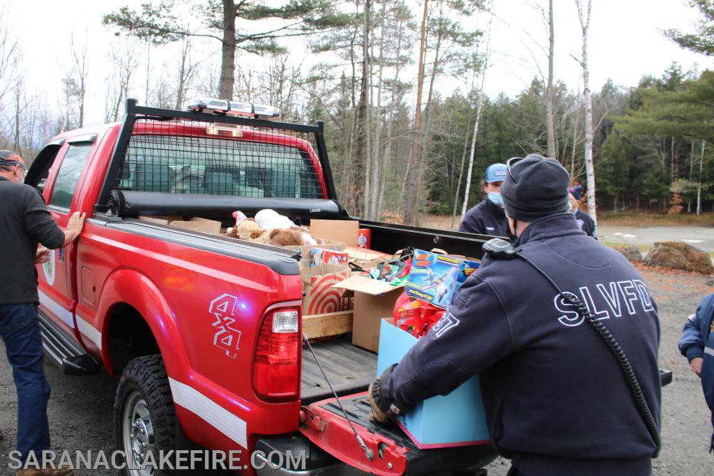 The Bloomingdale Volunteer Fire Department arrives with two truck loads of toys collected at the Bloomingdale Fire Station