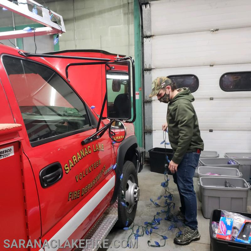On Thursday night, the night before the first drive through, SLVFD firefighters decorated the trucks to be used in the parade