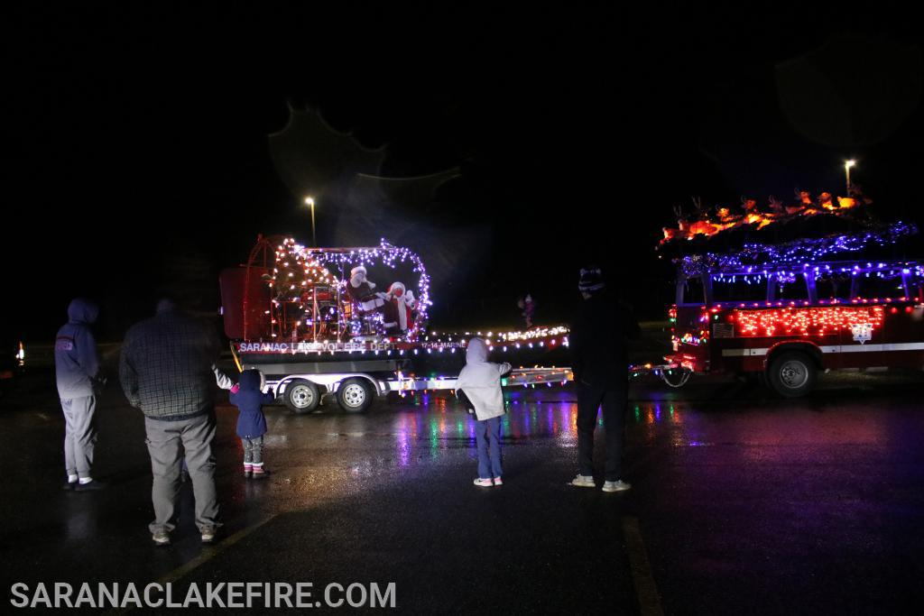 Santa and Mrs Claus were escorted through the streets of Saranac Lake on Friday and Saturday night.