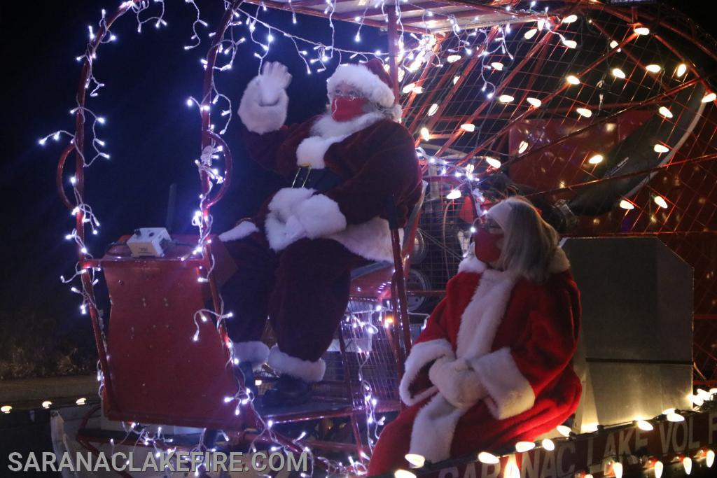 Santa and Mrs Claus rode through the streets of Saranac Lake on Friday and Saturday night to visit children who lined streets and some larger parking area's