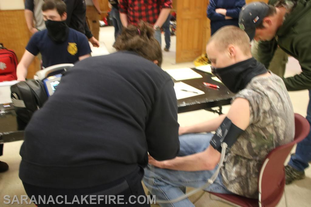 During the drill the firefighters had their vital signs monitored by the Saranac Lake Volunteer Rescue Squad.