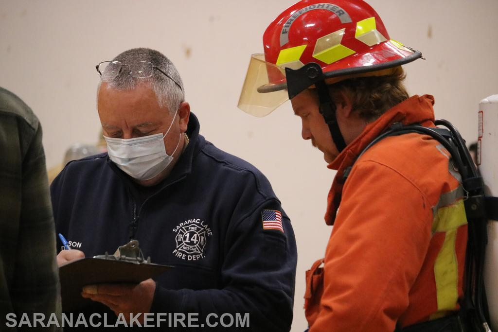 SLVFD Assistant Chief Tim Donaldson records statistics on each firefighters air consumption.