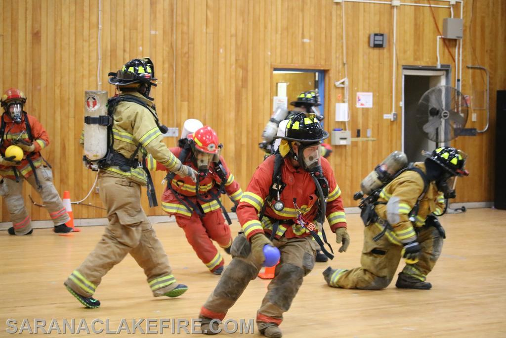Area firefighters play dodgeball to exert themselves with full protective gear including air packs on full air to determine how long they have to breath under full exertion.