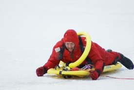 SLVFD Lieutenant Tim Donaldson works his way across thin ice to rescue his victim