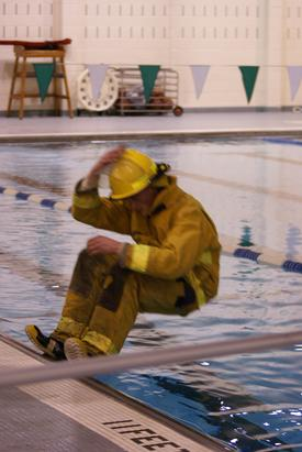 "Firefighter Erik Stender ""falling"" into 11 feet of water with full turn out gear"