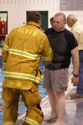 A wet 1st Assistant Chief Casey Taylor is congratulated by Dive Captain Ken Mclaughlin after surviving his fall!!!
