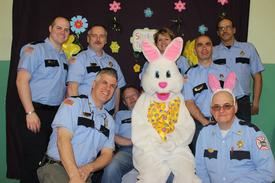 "Firefighters pose with Easter Bunny... back L-R Keegan Muldowney, Jim Stinson, Ken McLaughlin, Debbie Zerrahn, James D'Ambro, and John Duchaine. Front Brendan Keough, ""The Easter Bunny"" and Andy McGill."